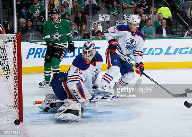Anders Nilsson of the Edmonton Oilers kicks aside a shot against the Dallas Stars at the American Airlines Center on October 13 2015 in Dallas Texas