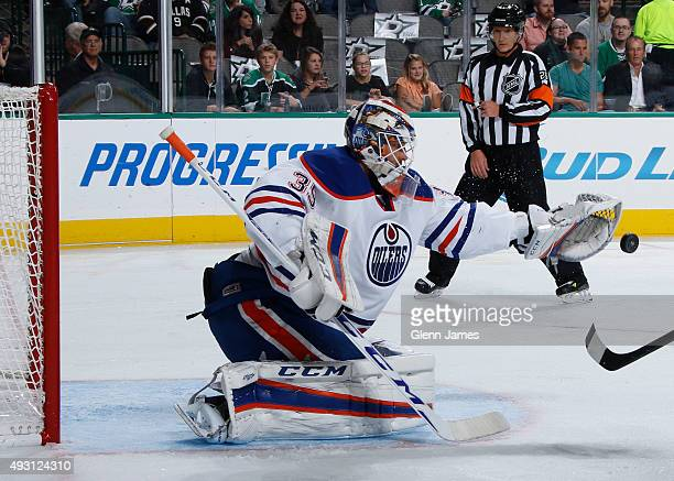 Anders Nilsson of the Edmonton Oilers makes a save against the Dallas Stars at the American Airlines Center on October 13 2015 in Dallas Texas
