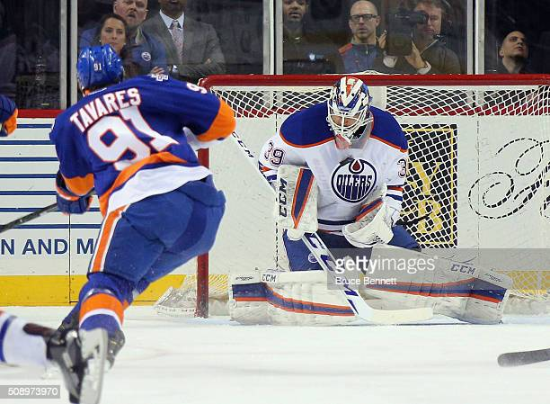 Anders Nilsson of the Edmonton Oilers makes the first period chest save on John Tavares of the New York Islanders at the Barclays Center on February...