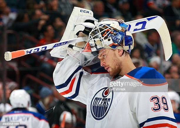 Anders Nilsson of the Edmonton Oilers skates to his crease during their NHL game against the Vancouver Canucks at Rogers Arena October 18 2015 in...