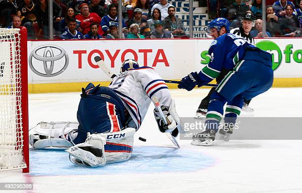 Anders Nilsson of the Edmonton Oilers stops Henrik Sedin of the Vancouver Canucks on a breakaway during their NHL game at Rogers Arena October 18...
