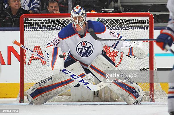 Anders Nilsson of the Edmonton Oilers watches an incoming shot against the Toronto Maple Leafs during an NHL game at Air Canada Centre on November 30...