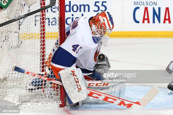 Anders Nilsson of the New York Islanders makes a glove save against the Ottawa Senators at Canadian Tire Centre on April 2 2014 in Ottawa Ontario...