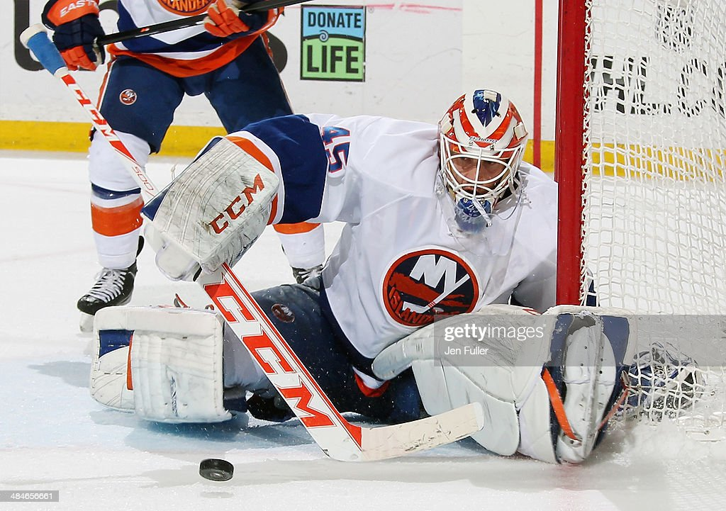 Anders Nilsson #45 of the New York Islanders makes a second period save against the Buffalo Sabres at First Niagara Center on April 13, 2014 in Buffalo, New York.
