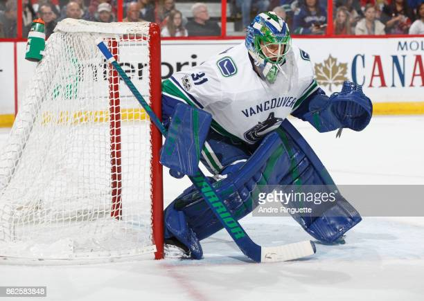 Anders Nilsson of the Vancouver Canucks guards his net during his shutout win against the Ottawa Senators at Canadian Tire Centre on October 17 2017...
