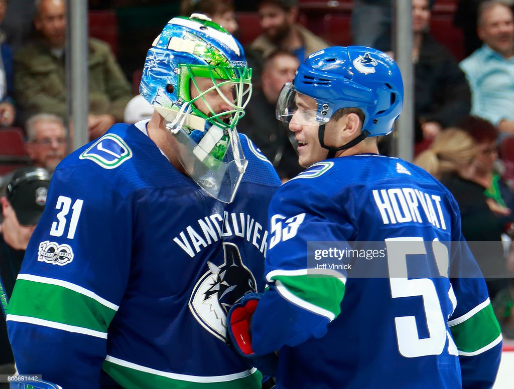 Anders Nilsson #31 of the Vancouver Canucks is congratulated by teammate Bo Horvat #53 after their 6-2 NHL win against the Washington Capitals at Rogers Arena October 26, 2017 in Vancouver, British Columbia, Canada.