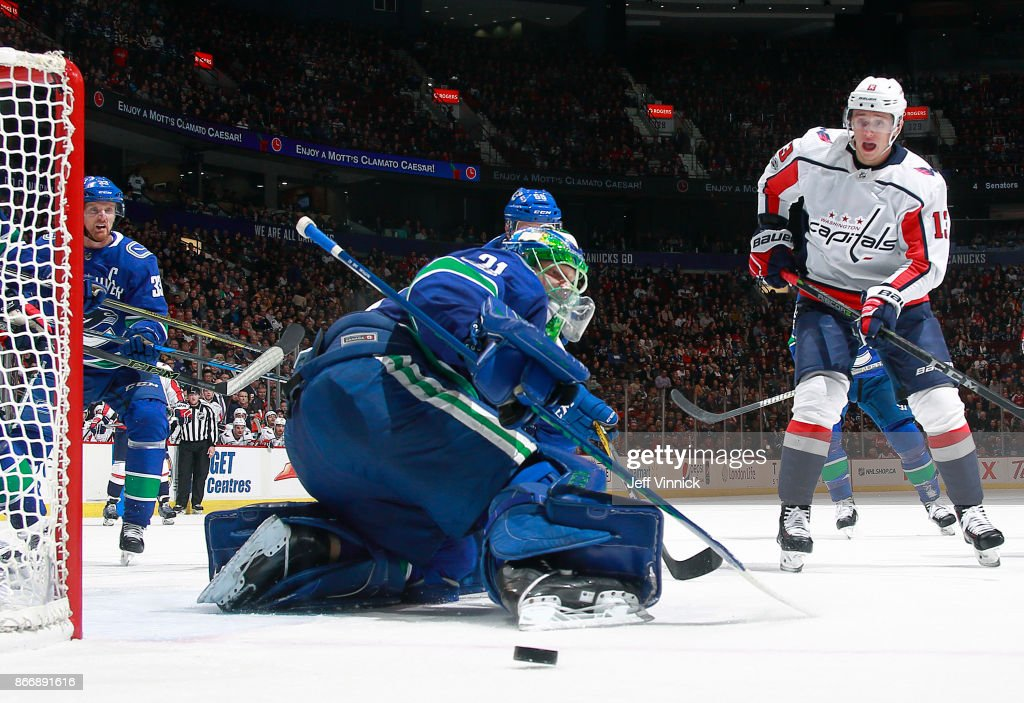 Anders Nilsson #31 of the Vancouver Canucks makes a save off the shot of Jakub Vrana #13 of the Washington Capitals during their NHL game at Rogers Arena October 26, 2017 in Vancouver, British Columbia, Canada. Vancouver won 6-2.