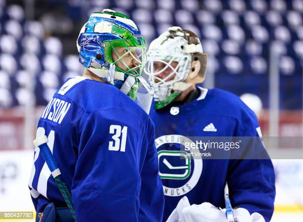 Anders Nilsson of the Vancouver Canucks skates by teammate Jacob Markstrom during their gameday skate at MercedesBenz Arena September 21 2017 in...