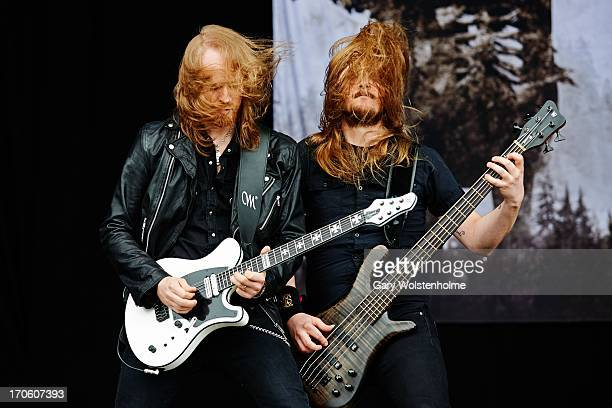 Anders Nystrom and Niklas Sandin of Katatonia performs on stage on Day 2 of Download Festival 2013 at Donnington Park on June 15 2013 in Donnington...