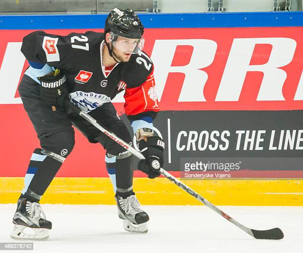 Anders Overmark of Vojens controls the puck during the Champions Hockey League group stage game between SonderjyskE Vojens and HV71 Jonkoping on...