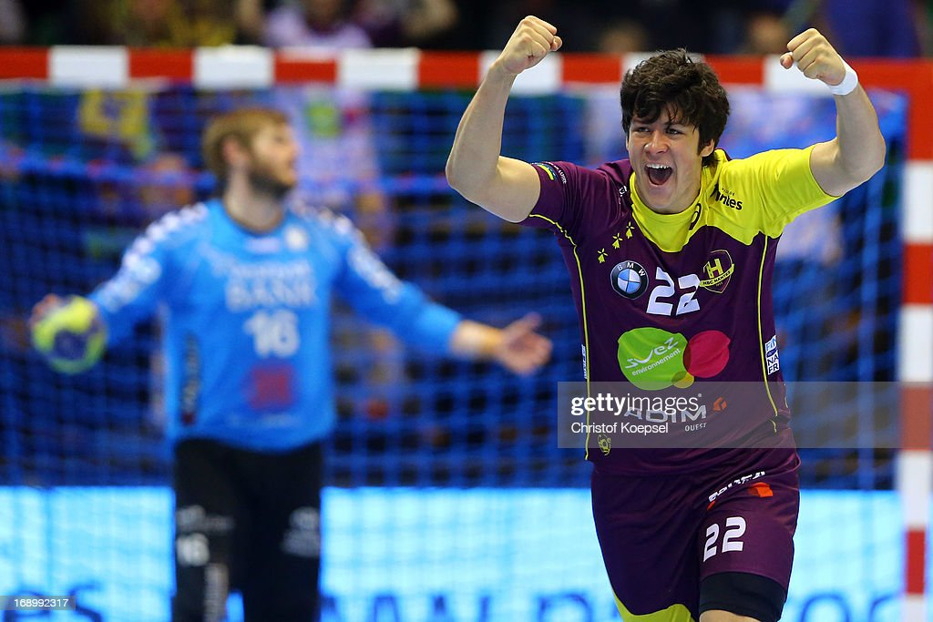 Anders Petersen of Holstebro looks dejected and Nicolas Tournat of Nantes celebrats during the EHF Cup Semi Final match between Tvis Holstebro and HBC Nantes at Palais des Sports de Beaulieu on May 18, 2013 in Nantes, France.