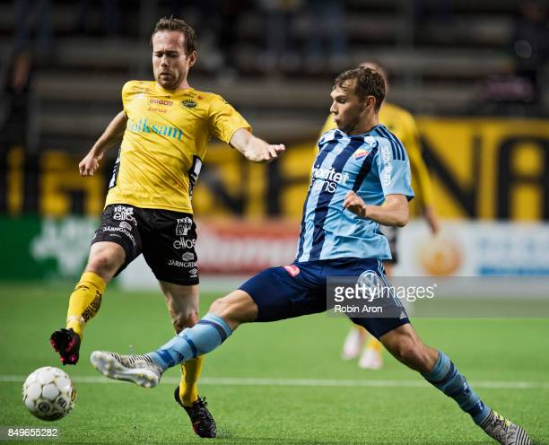 Anders Randrup of IF Elfsborg and Jesper Karlstrom of Djurgardens IF competes for the ball during the Allsvenskan match between IF Elfsborg and...