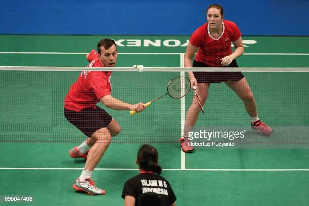 Anders Skaarup Rasmussen and Maiken Fruegaard of Denmark compete against Yantoni Edy Saputra and Marsheilla Gischa Islami of Indonesia during their...