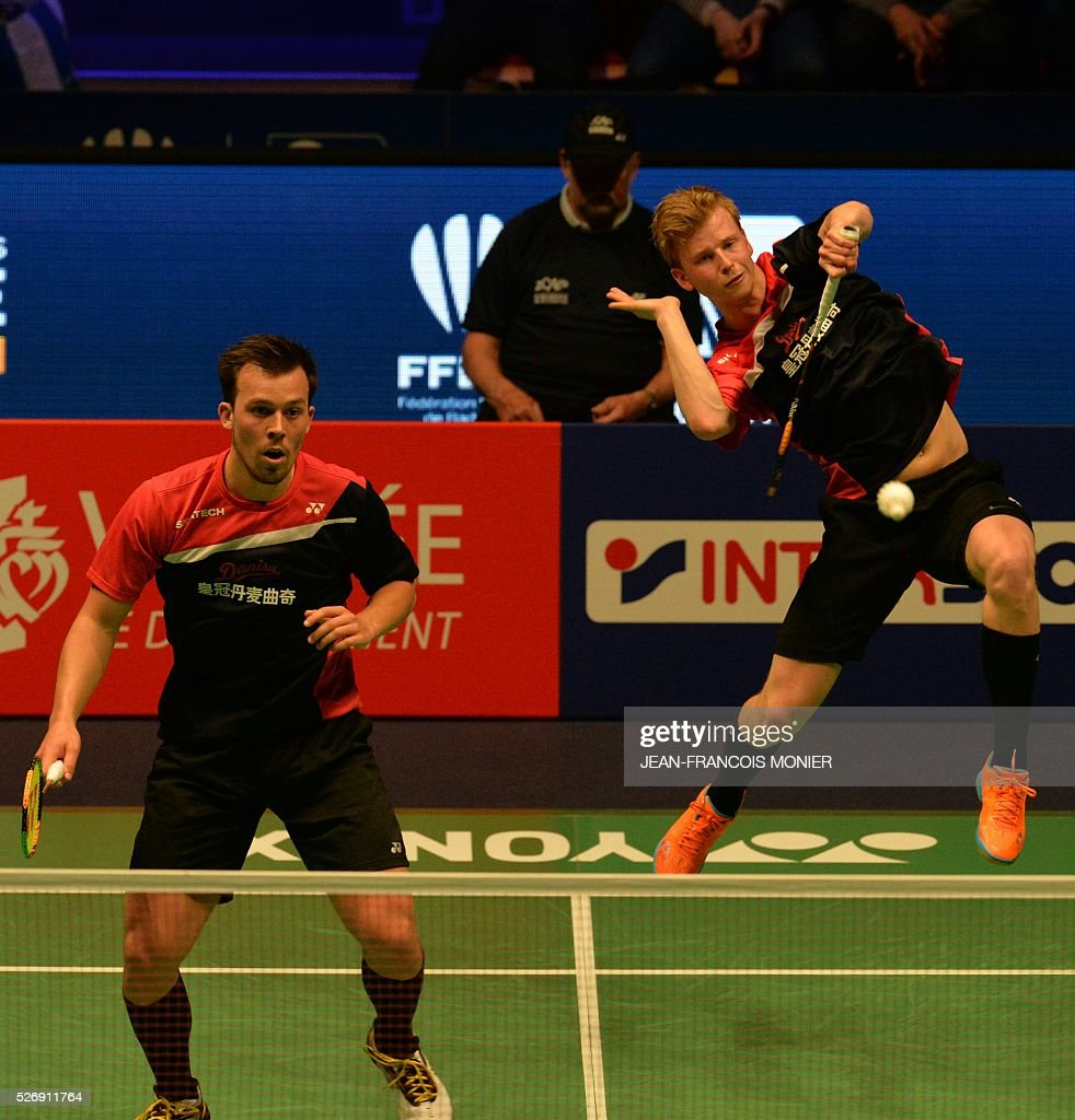 Anders Skaarup Rasmussen (front), flanked by teammate Denmark's Kim Astrup, hits a return to Denmark's Mads Conrad-Petersen and temmate Pieler Kolding during their 2016 European Championships Badminton double men's final match, on May 1, 2016 in Mouilleron-le-Captif, western France. / AFP / JEAN