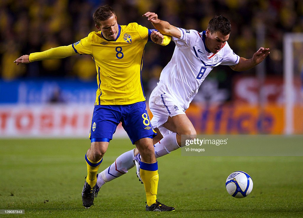 <a gi-track='captionPersonalityLinkClicked' href=/galleries/search?phrase=Anders+Svensson&family=editorial&specificpeople=167083 ng-click='$event.stopPropagation()'>Anders Svensson</a> of Sweden and Kevin Strootman of Holland during the EURO 2012 Qualifying match between Sweden and Netherlands at the Rasunda stadium on October 11, 2011 in Solna, Stockholm, Sweden.