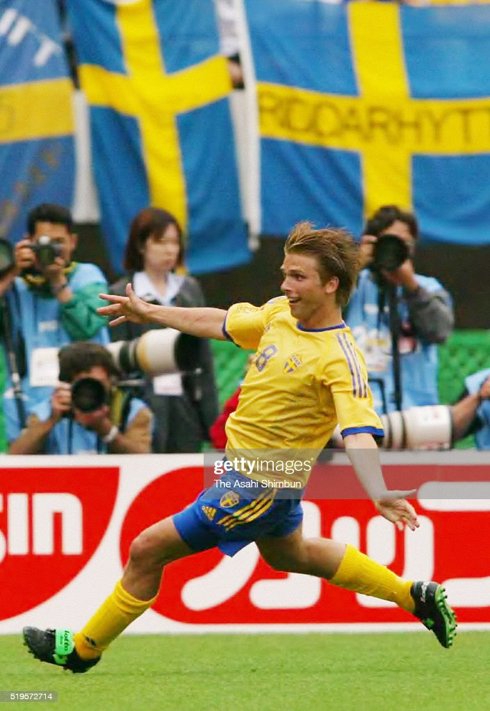 <a gi-track='captionPersonalityLinkClicked' href=/galleries/search?phrase=Anders+Svensson&family=editorial&specificpeople=167083 ng-click='$event.stopPropagation()'>Anders Svensson</a> of Sweden celebrates scoring his team's first goal during the FIFA World Cup Korea/Japan Group F match between Sweden and Argentina at the Miyagi Stadium on June 12, 2002 in Rifu, Miyagi, Japan.