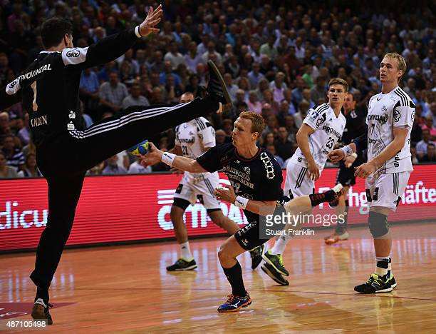 Anders Zachariassen of Flensburg scores a goal during the DKB Handball Bundeslga match between SG FlensburgHandewitt and THW Kiel at FlensArena on...