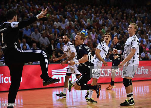 Anders Zachariassen of Flensburg throws a goal during the DKB Handball Bundeslga match between SG FlensburgHandewitt and THW Kiel at FlensArena on...