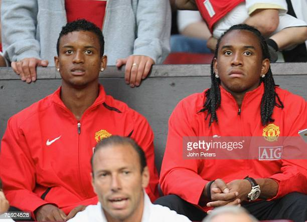 Anderson and Nani of Manchester United watches from the stand during the preseason friendly match between Manchester United and Inter Milan at Old...
