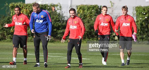 Anderson Anders Lindegaard Juan Mata Adnan Januzaj and Luke Shaw of Manchester United in action during a first team training session at Aon Training...