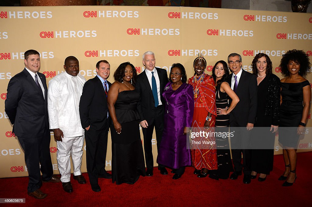 Anderson Cooper (Center) poses with the 2013 CNN Heroes, Dale Beatty, Georges Bwelle, Chad Pregracke, Tawanda Jones, Estella Pyfrom, Kakenya Ntaiya, Danielle Gletow, Richard Nares, Laura Stachel and Robin Emmons at the 2013 CNN Heroes: An All Star Tribute at The American Museum of Natural History on November 19, 2013 in New York City. 24079_013_0089.JPG