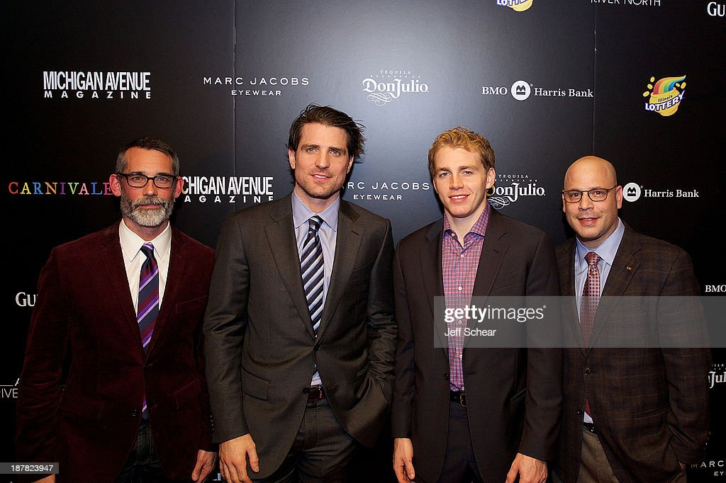 J.P. Anderson, Editor-In-Chief of Michigan Avenue Magazine, Patrick Sharp, Patrick Kane, and Dan Uslan, President and Publisher of Michigan Avenue Magazine, attend Michigan Avenue Magazine November Cover Celebration Hosted By Chicago Blackhawks' Patrick Sharp & Patrick Kane at Carnivale on November 12, 2013 in Chicago, Illinois.