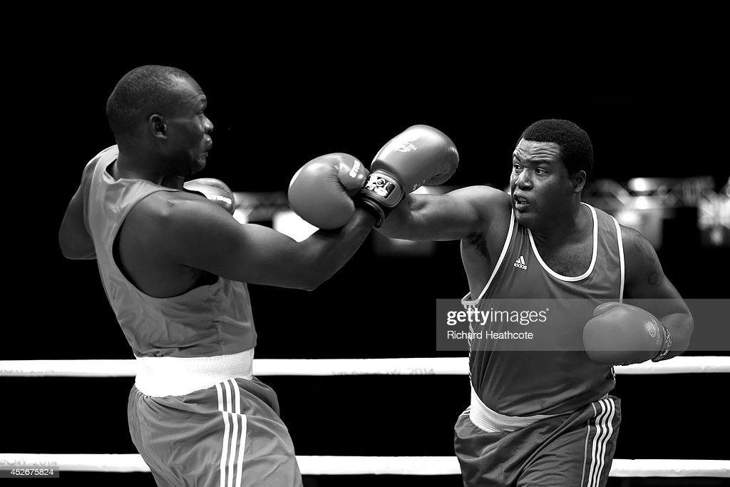 Anderson Emmanuel of Barbados (right) in action against Mike Sekabembe of Uganda in the Men's Super Heavy +91kg preliminaries at Scottish Exhibition And Conference Centre during day two of the Glasgow 2014 Commonwealth Games on July 25, 2014 in Glasgow, United Kingdom.