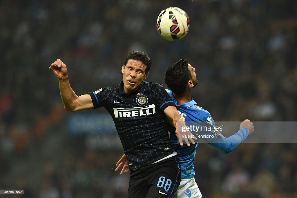 Anderson <a gi-track='captionPersonalityLinkClicked' href=/galleries/search?phrase=Hernanes&family=editorial&specificpeople=4522139 ng-click='$event.stopPropagation()'>Hernanes</a> (L) of FC Internazionale Milano clashes with Miguel Angel Britos of SSC Napoli during the Serie A match between FC Internazionale Milano and SSC Napoli at Stadio Giuseppe Meazza on October 19, 2014 in Milan, Italy.