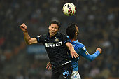 Anderson Hernanes of FC Internazionale Milano clashes with Miguel Angel Britos of SSC Napoli during the Serie A match between FC Internazionale...