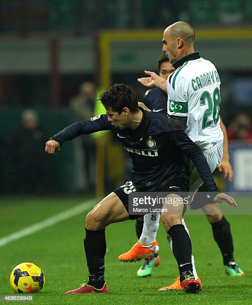 Anderson Hernanes of FC Internazionale Milano competes for the ball with Paolo Cannavaro of US Sassuolo Calcio during the Serie A match between FC...