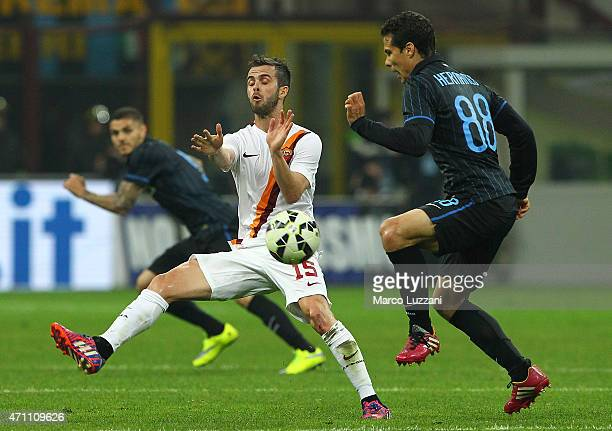 Anderson Hernanes of FC Internazionale Milano is challenged by Miralem Pjanic of AS Roma during the Serie A match between FC Internazionale Milano...