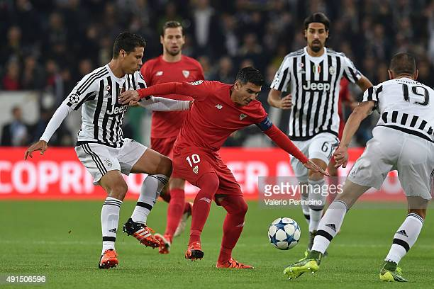 Anderson Hernanes of Juventus competes with Jose Antonio Reyes of Sevilla during the UEFA Champions League group E match between Juventus and Sevilla...