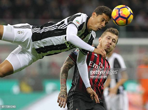 Anderson Hernanes of Juventus FC competes for the ball with Juraj Kucka of AC Milan during the Serie A match between AC Milan and Juventus FC at...