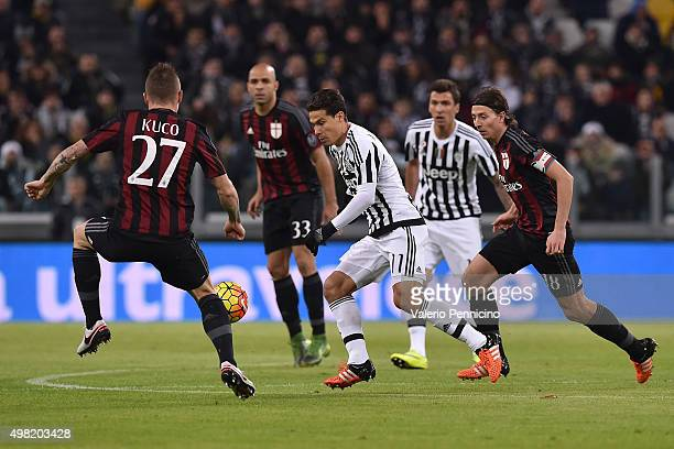 Anderson Hernanes of Juventus FC in action against Juraj Kucka and Riccardo Montolivo of AC Milan during the Serie A match between Juventus FC and AC...