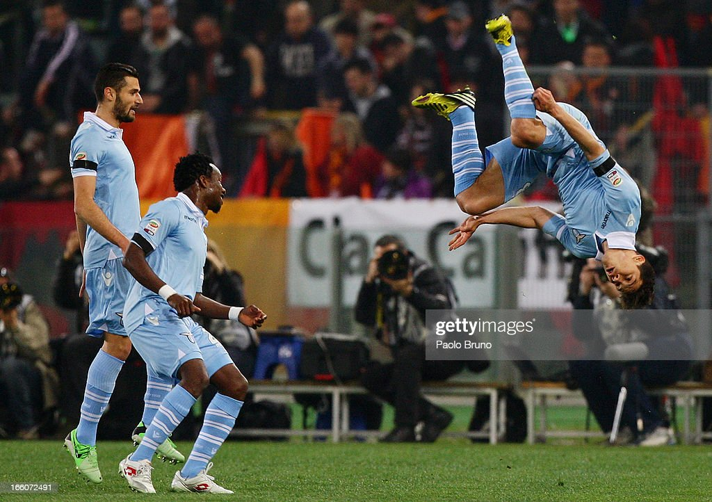 Anderson <a gi-track='captionPersonalityLinkClicked' href=/galleries/search?phrase=Hernanes&family=editorial&specificpeople=4522139 ng-click='$event.stopPropagation()'>Hernanes</a> (R) of S.S. Lazio celebrates with his teammates after scoring the opening goal during the Serie A match between AS Roma and S.S. Lazio at Stadio Olimpico on April 8, 2013 in Rome, Italy.