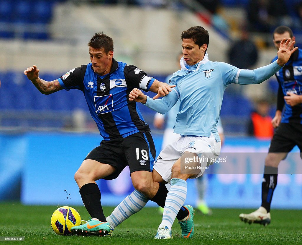 Anderson <a gi-track='captionPersonalityLinkClicked' href=/galleries/search?phrase=Hernanes&family=editorial&specificpeople=4522139 ng-click='$event.stopPropagation()'>Hernanes</a> (R) of S.S. Lazio competes for the ball with <a gi-track='captionPersonalityLinkClicked' href=/galleries/search?phrase=German+Denis&family=editorial&specificpeople=4609854 ng-click='$event.stopPropagation()'>German Denis</a> of Atalanta BC during the Serie A match between S.S. Lazio and Atalanta BC at Stadio Olimpico on January 13, 2013 in Rome, Italy.
