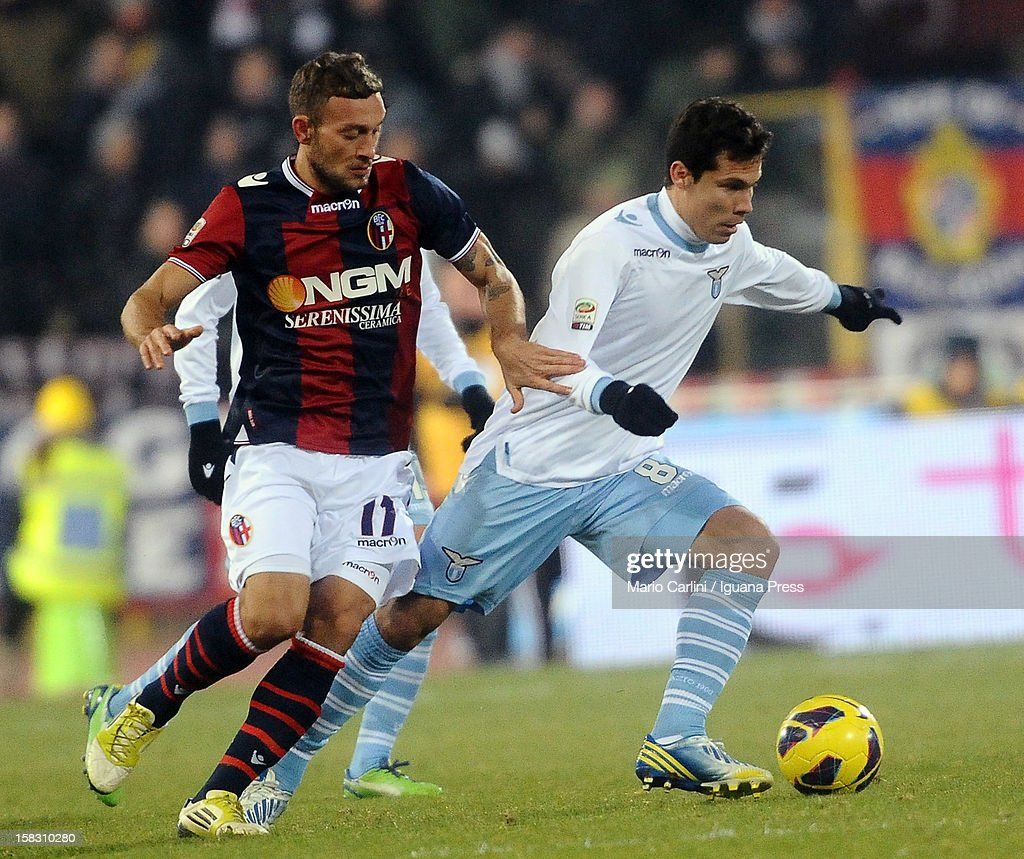 Anderson Hernanes (R) of SS Lazio competes for the ball with <a gi-track='captionPersonalityLinkClicked' href=/galleries/search?phrase=Tiberio+Guarente&family=editorial&specificpeople=4667653 ng-click='$event.stopPropagation()'>Tiberio Guarente</a> of Bologna FC during the Serie A match between Bologna FC and S.S. Lazio at Stadio Renato Dall'Ara on December 10, 2012 in Bologna, Italy.