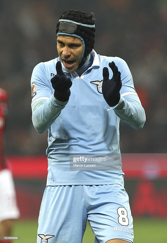 Anderson <a gi-track='captionPersonalityLinkClicked' href=/galleries/search?phrase=Hernanes&family=editorial&specificpeople=4522139 ng-click='$event.stopPropagation()'>Hernanes</a> of S.S. Lazio gestures during the Serie A match between AC Milan and S.S. Lazio at San Siro Stadium on March 2, 2013 in Milan, Italy.