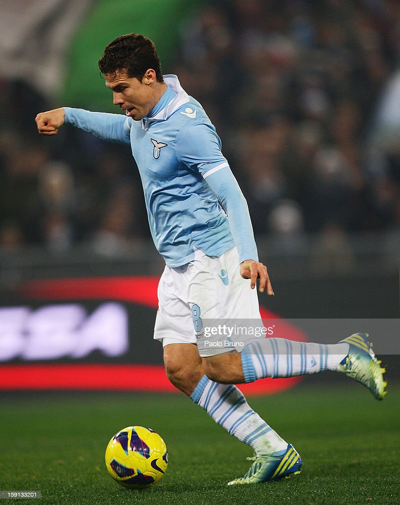 Anderson <a gi-track='captionPersonalityLinkClicked' href=/galleries/search?phrase=Hernanes&family=editorial&specificpeople=4522139 ng-click='$event.stopPropagation()'>Hernanes</a> of S.S. Lazio scores the team's third goal during the TIM Cup match between S.S. Lazio and Calcio Catania at Stadio Olimpico on January 8, 2013 in Rome, Italy.