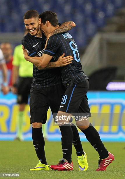 Anderson Hernanes with his teammate Mauro Icardi of FC Internazionale Milano celebrates after scoring the team's first goal during the Serie A match...