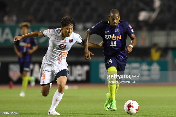 Anderson Lopes of Sanfrecce Hiroshima and Kazuma Takayama of Omiya Ardija compete for the ball during the JLeague J1 match between Sanfrecce...