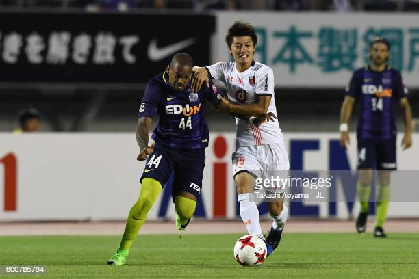 Anderson Lopes of Sanfrecce Hiroshima and Keisuke Oyama of Omiya Ardija compete for the ball during the JLeague J1 match between Sanfrecce Hiroshima...