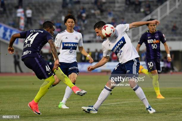 Anderson Lopes of Sanfrecce Hiroshima and Milos Degenek of Yokohama FMarinos compete for the ball during the JLeague J1 match between Sanfrecce...