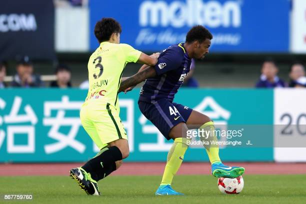 Anderson Lopes of Sanfrecce Hiroshima and Tomoya Ugajin of Urawa Red Diamonds compete for the ball during the JLeague J1 match between Sanfrecce...
