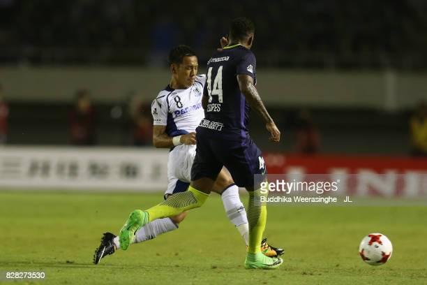 Anderson Lopes of Sanfrecce Hiroshima and Yosuke Ideguchi of Gamba Osaka compete for the ball during the JLeague J1 match between Sanfrecce Hiroshima...