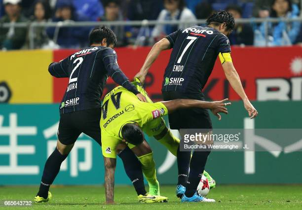 Anderson Lopes of Sanfrecce Hiroshima competes for the ball against Genta Miura and Yasuhito Endo during the JLeague J1 match between Gamba Osaka and...