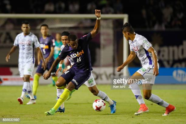 Anderson Lopes of Sanfrecce Hiroshima competes for the ball against Eder Lima and Yusuke Tanaka of Ventforet Kofu compete for the ball during the...