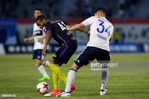 Anderson Lopes of Sanfrecce Hiroshima controls the ball under pressure of Milos Degenek of Yokohama FMarinos during the JLeague J1 match between...