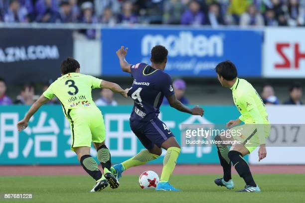 Anderson Lopes of Sanfrecce Hiroshima controls the ball under pressure of Tomoya Ugajin and Takuya Aoki of Urawa Red Diamonds during the JLeague J1...