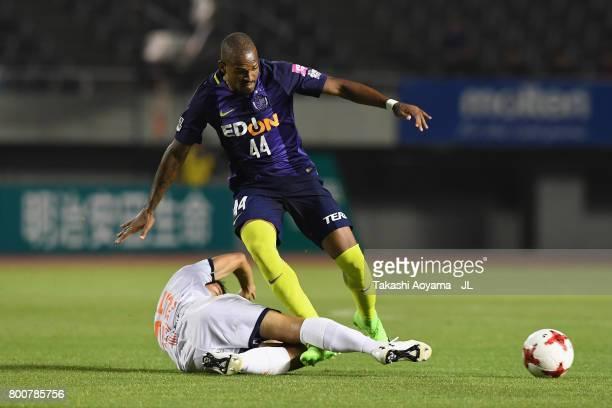 Anderson Lopes of Sanfrecce Hiroshima is tackled by Kazuma Takayama of Omiya Ardija during the JLeague J1 match between Sanfrecce Hiroshima and Omiya...
